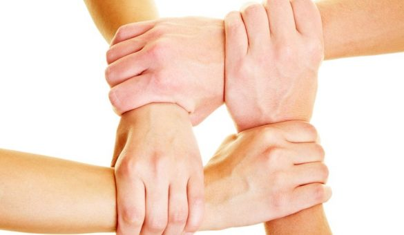 5529313 - hands holding other hands on the wrists
